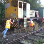 Nationwide Building Society volunteers thought that the fishplate task wasn't enough exercise, so Helen, Rob and Paul did some competitive team building..... only to find out that the hand brake was on!. Note: no rail movements were undertaken during the Give and Gain day and railway volunteers were present at all times. Photo: D.Millard