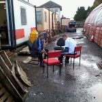 Nationwide Building Society volunteers sit outside (once the rain had stopped) brushing the rust off some track (fishplate) bolts. Photo: David Millard