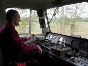 Gary Austin is seen at the controls of Class 47205