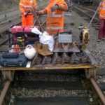 Next step. Chris and James Coulson have just pushed the trolley along the line from Pitsford & Brampton with half a ton of tools, generator, and new check rail chairs to accept the left and right hand splayed ends of the new check rails we've just made. Time for the team to get to work. Photo: Graham Peacock